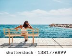 young woman watching the sea... | Shutterstock . vector #1381776899