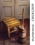 Small photo of butter churn in old kitchen