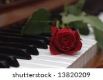 single rose placed over piano...   Shutterstock . vector #13820209