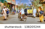 MARRAKESH ,MOROCCO - OCT 4: Unidentified people at a street in Marrakesh on Oct.  4, 2012 in Morocco. With a population of over 900,000 inhabitants it is the most important city in Morocco.  - stock photo