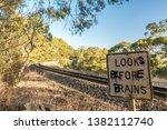 Graffitied Warning Sign At A...