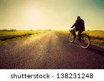 old man riding a bike on... | Shutterstock . vector #138231248