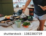 breakfast table and woman... | Shutterstock . vector #1382383739