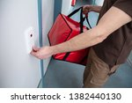 pizza delivery man ringing the... | Shutterstock . vector #1382440130