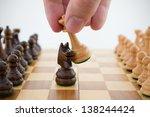 chess game. queen captures horse | Shutterstock . vector #138244424