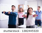 young businesspeople exercising ... | Shutterstock . vector #1382445320