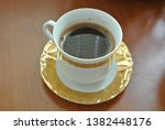 vintage coffee cup on table | Shutterstock . vector #1382448176