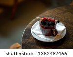 hot cherry cocktail standing on ... | Shutterstock . vector #1382482466