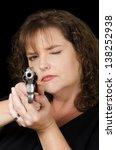 woman holding loaded gun | Shutterstock . vector #138252938