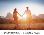 young happy couple posing on... | Shutterstock . vector #1382697623