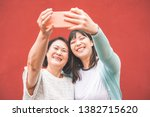 asian mother and daughter... | Shutterstock . vector #1382715620