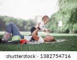 mom and her little son play... | Shutterstock . vector #1382754716