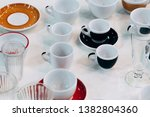 various tea cups on white table ... | Shutterstock . vector #1382804360