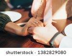 loving couple holds hands ...   Shutterstock . vector #1382829080