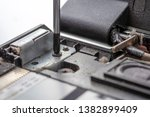 the screwdriver unscrews the...   Shutterstock . vector #1382899409