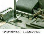 the screwdriver unscrews the...   Shutterstock . vector #1382899433