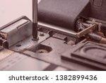 the screwdriver unscrews the...   Shutterstock . vector #1382899436