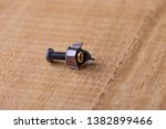 a shiny metal bolt securing the ...   Shutterstock . vector #1382899466