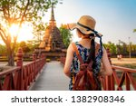 Small photo of Sunset and light in Sukhothai historical park and wat Sri chum with Asian traveller walking on the temple, this image can use for travel, Bangkok, Thailand and landmark in aisa concept