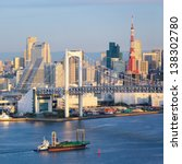 Skyline of Tokyo as seen from Odaiba at sunset - stock photo