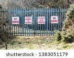 Signs On A Security Gate...