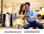 smiling young couple looking at ... | Shutterstock . vector #138306533