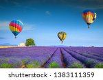 Small photo of Amazing flowery summer landscape. Flying colorful hot air balloons over the purple fragrant lavender fields, Valensole, Provence, France, Europe. Travel and recreation concept
