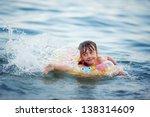 girl splashing in the sea | Shutterstock . vector #138314609