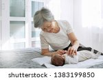 great grandmother plays with a... | Shutterstock . vector #1383199850