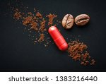 Red pill and coffee beans on a...