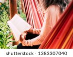 reading a paper book old style... | Shutterstock . vector #1383307040