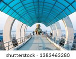 Small photo of Rayong, Thailand - March 31, 2019: View of entrance pier gate to Samed Island with the Pisue Samutr sculpture or a female yak who can transmute herself into a beautiful girl in Rayong, Thailand.