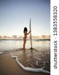 surfer girl at sunrise  gold... | Shutterstock . vector #1383558320