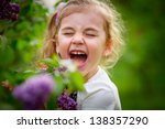 smiling girl near the lilacs in ... | Shutterstock . vector #138357290
