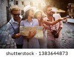 group of happy friends enjoying ... | Shutterstock . vector #1383644873
