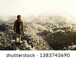 man stands on top of plastic... | Shutterstock . vector #1383743690