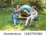 Stock photo people tourism and nature concept couple having fun on camping trip and play with cat 1383790586