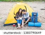 Stock photo people tourism and nature concept couple having fun on camping trip and play with cat 1383790649