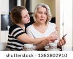 upset mature mother with adult... | Shutterstock . vector #1383802910
