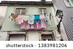 old colorful and tiled facades... | Shutterstock . vector #1383981206