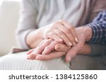 hands of mature wife or carer...