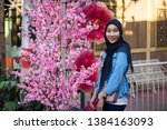 asian hijab girl with pink... | Shutterstock . vector #1384163093