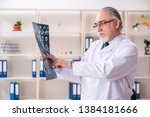 aged male doctor radiologist in ... | Shutterstock . vector #1384181666