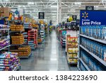 Small photo of Miami/USA - April, 25 2019:Rows with products in Walmart. Walmart Inc. is an American multinational retail corporation operates a chain of hypermarkets, discount department stores, and grocery stores