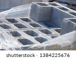 Small photo of Concrete block bricks in stack for wall construction. Concrete block, cinder blocks, breeze blocks, hollow blocks, Besser blocks or Besser bricks wall background, brick texture