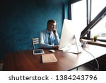 mature businessman working on... | Shutterstock . vector #1384243796