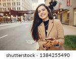 beautiful girl in a city.... | Shutterstock . vector #1384255490