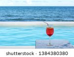 cold drink by the pool in the... | Shutterstock . vector #1384380380