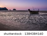 old fishing boats at low tide... | Shutterstock . vector #1384384160