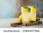 two glass with lemonade or... | Shutterstock . vector #1384447586